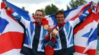 Britain's Tim Baillie and Etienne Stott show off their gold medals
