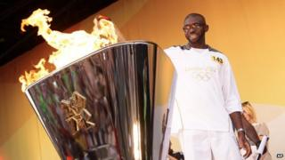 Fabrice Muamba lighting Olympic torch