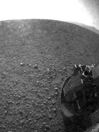 Nasa's Curiosity has sent back pictures from the surface of Mars.