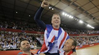 Chris Hoy celebrates winning his record sixth gold medal.