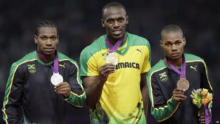 Usain Bolt with Yohan Blake and Warren Weir.