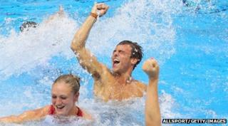 Tom Daley celebrates in the pool