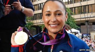 Jessica Ennis holds up her medal.