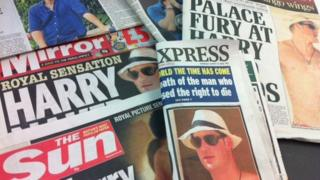 Papers with the story about Prince Harry on the front.