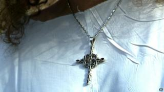 Christian cross on a necklace