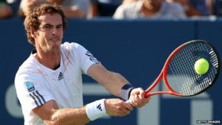 "Andy Murray of Great Britain returns a shot against Marin Cilic of Croatia during their men""s singles quarterfinal match on Day Ten of the 2012 US Open."