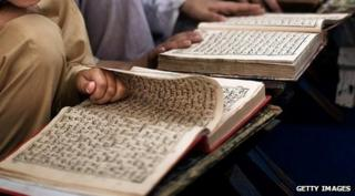 Children reading the Koran