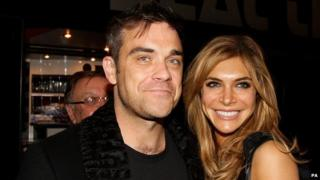 Robbie Williams and his wife.
