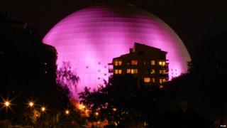 Ericsson Globe Arena in Sweden lit up pink