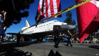 Space shuttle Endeavour travels along Los Angeles streets. Photo: 14 October 2012