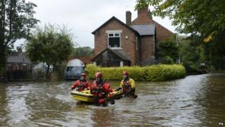 Rescue workers in summer floods