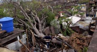 Homes in Jamaica destroyed by Hurricane Sandy