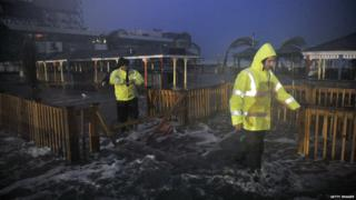 People walk through the flood water in Atlantic City.
