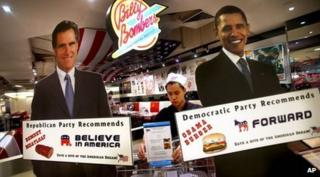 Campaign cutouts of Romney and Obama