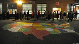People enter Washington Mill Elementary School to cast their vote in Alexandria, Virginia