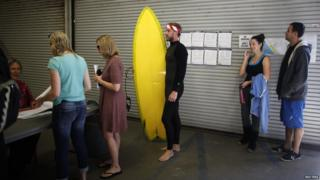 Surfer Mike Wegart, 30, waits to vote at Venice Beach lifeguard station in Los Angeles, California