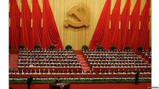 Party leaders listen to the speech of Hu Jintao, bottom, Chinese president and Communist Party general secretary, at the opening session of the Communist Party congress at the Great Hall of the People in Beijing, 8 November 2012