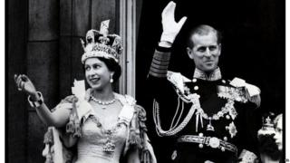 Queen and Duke waving at her Coronation.