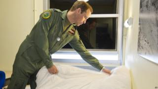 Prince William making his bed.