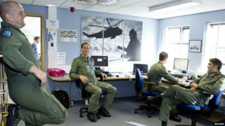 Britain's Prince William speaks to colleagues at RAF Valley in Holyhead, Wales