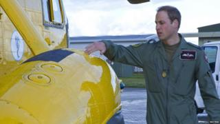 Prince William carrying out a check on his air craft.