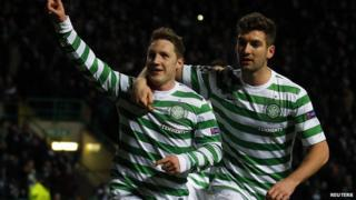 Kris Commons celebrates with teammate Charlie Mulgrew