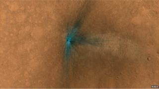 The surface of Mars captured by the Nasa Mars Reconnaissance Orbiter shows a large impact.