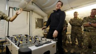 David Cameron plays table football