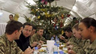 David Cameron eats dinner with British troops.