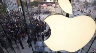 People line up to enter a newly-opened Apple Store