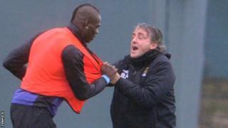 Manchester City striker Mario Balotelli and manager Roberto Mancini