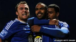 Macclesfield's Matthew Barnes-Homer celebrates with teammates
