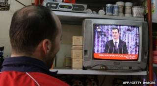 Man watches President Assad's speech