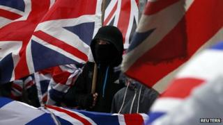 Protestor holds Union flag