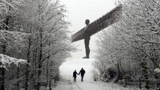 Snow covers the Angel of the North near Gateshead, northeast England