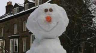 The snowman is given a face with a carrot nose and chocolate button eyes.