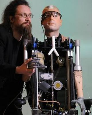 Bionic man with one of the robotics experts who helped build it.
