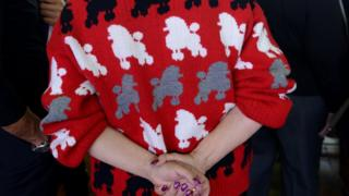 Lady wears poodle jumper