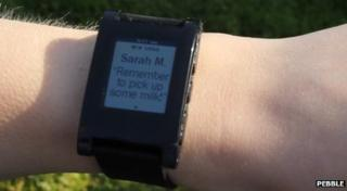 A smartwatch showing a notification