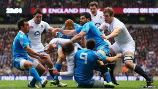 Toby Flood of England is tackled during match against Italy