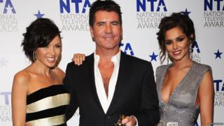 Cheryl with Simon Cowell and Dannii Minogue.