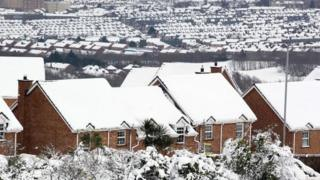 Rooftops are covered in snow in Belfast