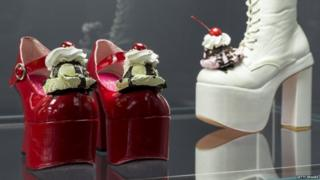 Shoes with ice-cream and cream piled on the toe.