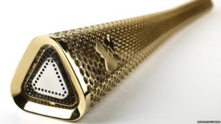 Gold looking Olympic Torch