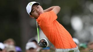Golfer Guan Tianlang playing at the masters