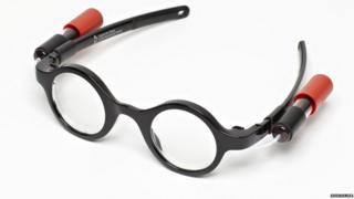A pair of thick-rimmed glasses.