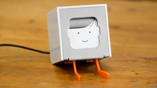 A little printer with a face.