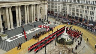 The coffin of British former prime minister Margaret Thatcher, carried on a gun carriage drawn by the King's Troop Royal Horse Artillery, arrives at St Paul's Cathedral during her ceremonial funeral in central London on April 17, 2013.
