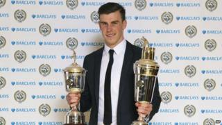 Gareth Bale with trophies.