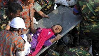 Woman being rescued from Dhaka building